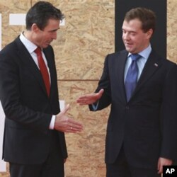 NATO Secretary General Anders Fogh Rasmussen, left, and Russian President Dmitry Medvedev are seen prior to participating in a NATO Russia Council meeting at a NATO summit in Lisbon (file photo)