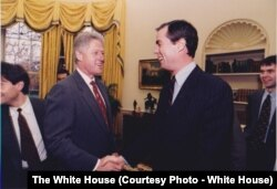 Senior White House Advisor John Angell with President Bill Clinton December 17, 1996. (White House Photo)