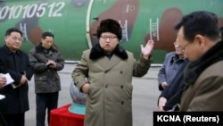 North Korean leader Kim Jong Un meets with scientists and technicians involved in the country's weapons program in this undated photo released by North Korea's Korean Central News Agency. Some in the West have asked if it is time to revisit the current strategy of relying only on sanctions to change Pyongyang's behavior.