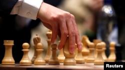 FILE - Magnus Carlsen v. Fabiano Caruana at the 2018 World Chess Championship, London, Nov. 26, 2018.