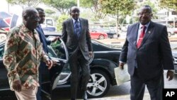 Vice President of Zimbabwe, Kembo Mohadi (Centre) and the Zimbabwean officials arrive at the Singapore Casket Funeral Parlour on Tuesday,10th September 2019 in Singapore.