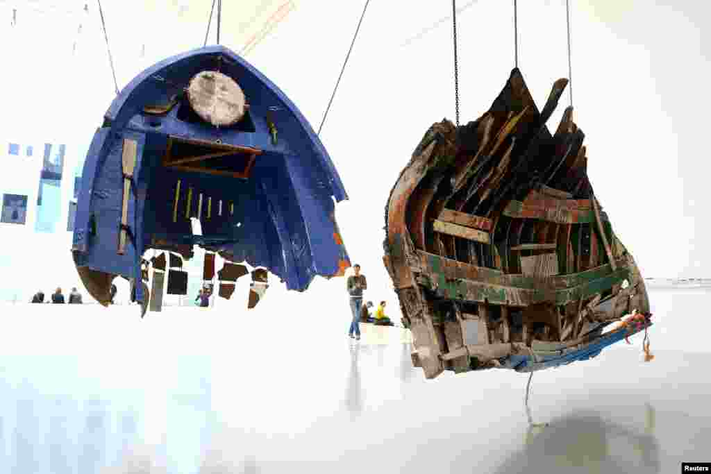"Remnants of boats used by refugees and recovered along the Greek coast are displayed as part of a project by Mexican artist Guillermo Galindo ahead of the opening of Germany's biggest art fair ""Documenta 14"" in Kassel, German, June 7, 2017."