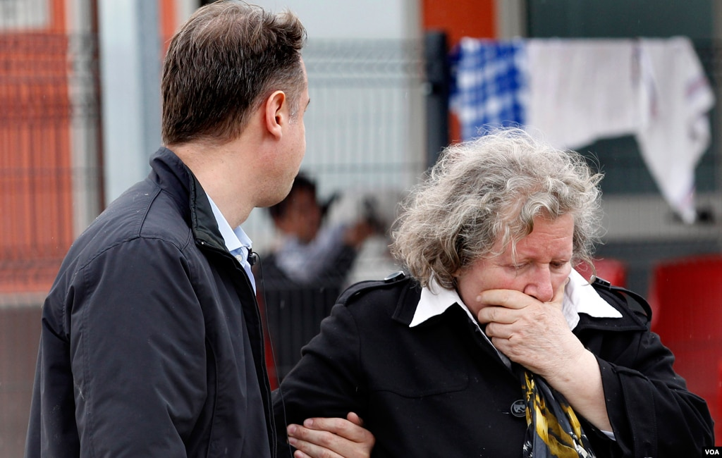 A woman and a man react right after an earthquake in Sant'Agostino, May 20. 2012. A magnitude-5.9 earthquake shook northern Italy toppling some buildings and delaying emergency services news reports said. (AP Photo/Luca Bruno)
