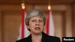 FILE - Britain's Prime Minister Theresa May makes a statement about Brexit in Downing Street in London, March 20, 2019.