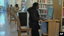 Administrators at Tidewater Community College in Virginia have launched a program to help prevent a tuition-loan crisis at their school, where students are shown working on computers in the college library, Norfolk, Virginia, November 2011.
