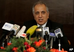 FILE - US politician Zalmay Khalilzad speaks during a news conference.