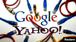 An illustration shows the logos of Google and Yahoo connected with LAN cables in a Berlin office Oct. 31, 2013. The U.S. National Security Agency has tapped into communications links used by Google and Yahoo to move huge amounts of email and other user in