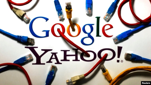 An illustration shows the logos of Google and Yahoo connected with LAN cables in a Berlin office Oct. 31, 2013.