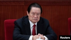 Former China's Politburo Standing Committee Member Zhou Yongkang attends the closing ceremony of the National People's Congress (NPC) at the Great Hall of the People in Beijing March 14, 2012. China's senior leadership has agreed to open a corruption investigation.