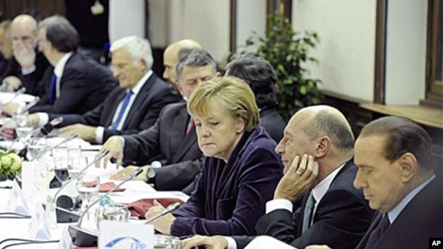 German Chancellor Angela Merkel, center, attends a round table during an EPP party meeting ahead of an EU summit in Brussels, 16 Dec 2010