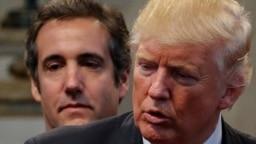 Cựu luật sư cá nhân của Tổng thống Donald Trump, Michael Cohen (sau), đã đứng ra chi trả những khoản tiền bịt miệng cho một nữ diễn viên phim người lớn và một cựu người mẫu Playboy nói từng có quan hệ tình dục với ông Trump.