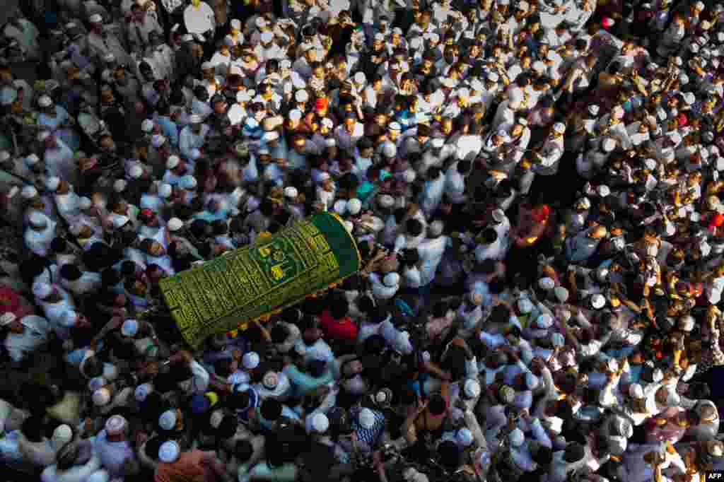 Mourners carry the coffin of prominent Muslim lawyer Ko Ni at the Muslim cemetery in Yangon, Myanmar. The lawyer and advisor to Aung San Suu Kyi, was gunned down outside Yangon airport in what the ruling National League for Democracy party said was a political assassination.