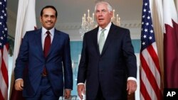 FILE - Secretary of State Rex Tillerson (right) meets with ‎Qatari Foreign Minister Sheikh Mohammed bin Abdulrahman Al Thani, June 27, 2017, at the State Department in Washington.