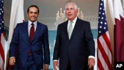 Secretary of State Rex Tillerson (right) meets with ‎Qatari Foreign Minister Sheikh Mohammed bin Abdulrahman Al Thani, June 27, 2017, at the State Department in Washington.
