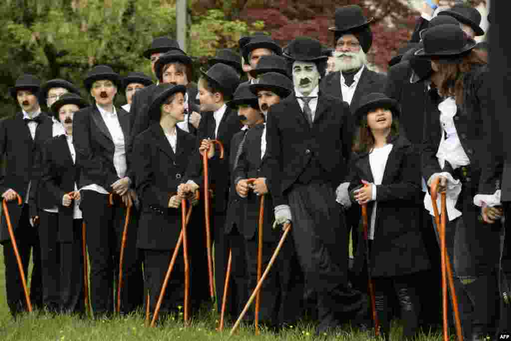 Some 662 people dressed as 'The Tramp' pose for a group picture to mark the first anniversary of Chaplin's World By Grevin, and Charlie Chaplin's birthday in Corsier-sur-Vevey, Switzerland.