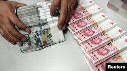 China tidak dapat membuat perubahan besar pada komposisi cadangan devisanya, karena diperlukan untuk pengelolaan nilai tukar renminbi (foto: ilustrasi).