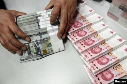 File A Clerk Counts Chinese Yuan And U S Dollar Banknotes At Branch Of Bank