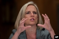 FILE - Homeland Security Secretary Kirstjen Nielsen testifies before the Senate Committee on Homeland Security & Governmental Affairs, on Capitol Hill, Oct. 10, 2018, in Washington.