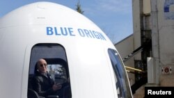 FILE - Amazon and Blue Origin founder Jeff Bezos addresses the media about the New Shepard rocket booster in Colorado Springs, Colorado, April 5, 2017.