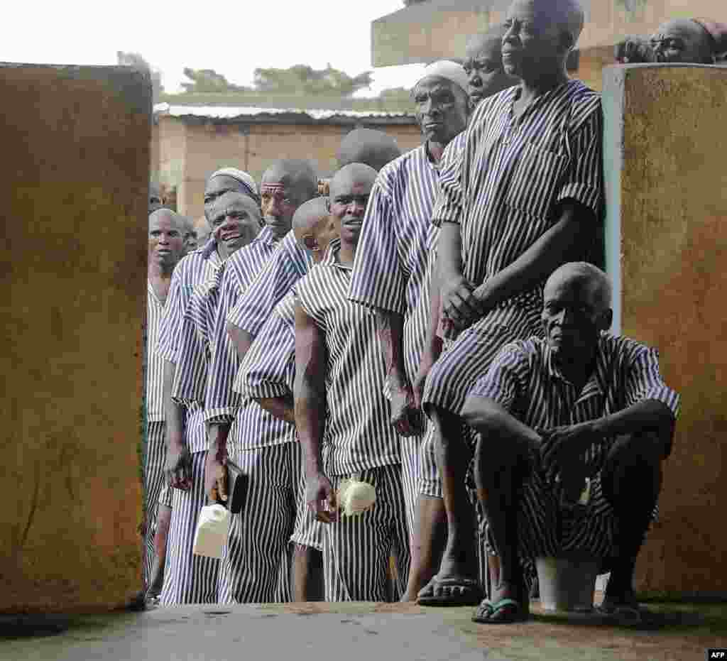 Kenyan prisoners wait in line to vote in Kisumu, on Lake Victoria. This is the first time that inmates in Kenya are permitted to vote. Kenyans began voting in general elections headlined by a too-close-to-call battle between incumbent Uhuru Kenyatta and his rival Raila Odinga, sparking fears of violence in east Africa's richest economy.