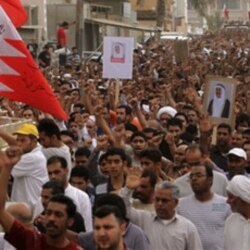 A crowd in Bahrain shouts anti-government statements at a funeral in April.