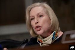 """Sen. Kirsten Gillibrand, D-N.Y., questions Marine Gen. Robert B. Neller, the commandant of the Marine Corps, at a Senate Armed Services Committee hearing on the investigation of nude photographs of female Marines and other women that were shared on the Facebook page """"Marines United,"""" on Capitol Hill in Washington, March, 14, 2017."""