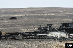 FILE - Debris of the A321 Russian airliner lie on the ground a day after the plane crashed in Wadi al-Zolomat, a mountainous area in Egypt's Sinai Peninsula, Nov. 1, 2015.