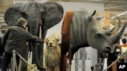 Big-game trophies are all around at an international hunting fair in Dortmund, Germany, Feb. 3, 2011.