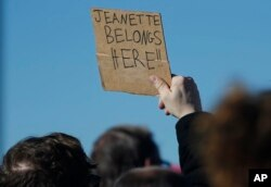 FILE - A supporter holds up a placard during a rally in support of Jeanette Vizguerra, a Mexican woman seeking to avoid deportation from the United States, outside the Immigration and Customs Enforcement office in Centennial, Colorado, Feb. 15, 2017.