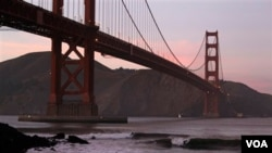 Surfers catch waves late in the day at Fort Point beneath the Golden Gate Bridge in San Francisco, Wednesday, Jan. 19, 2011. Sunny conditions and temperatures near 60 are forecast the rest of the week in the Bay area. (AP Photo/Eric Risberg)