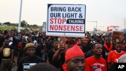 FILE - People are seen protesting against power cuts in Accra, Ghana, May 16, 2015.