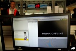 FILE - A computer screen is pictured at TV5 Monde after the French television network was hacked by people claiming allegiance to the Islamic State group, in Paris, France, April 9, 2015.