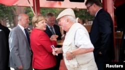 German Chancellor Angela Merkel visits a market in Greifswald, Germany, Aug. 30, 2016.