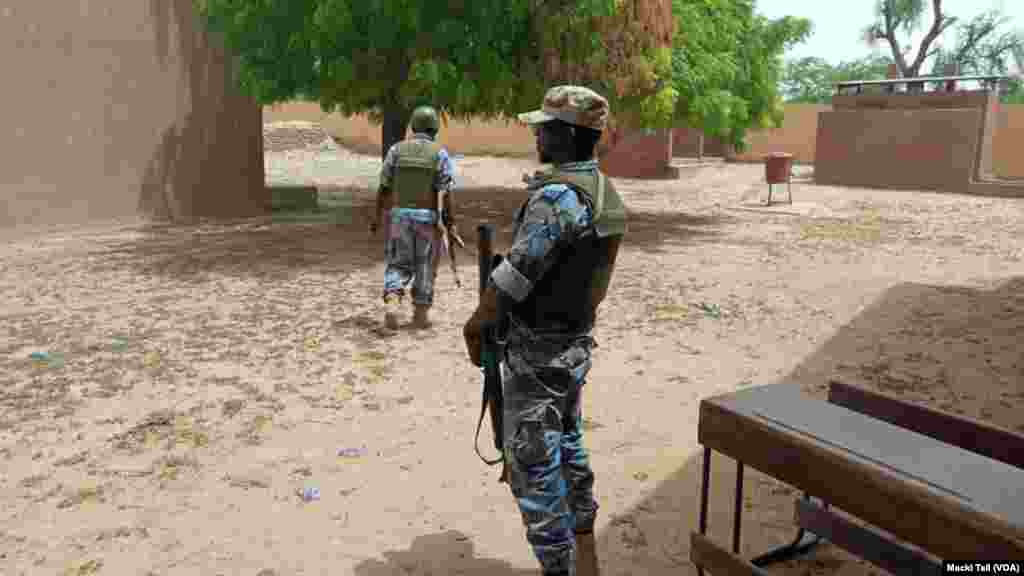 An armed security officer standing at a voting station, in the center town of Youwarou during July 29, 2018 malian presidential election. Photo Voa Bambara Macki Tall.