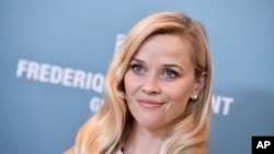 FILE - Reese Witherspoon arrives at the Variety Power of Women luncheon at the Beverly Wilshire hotel.