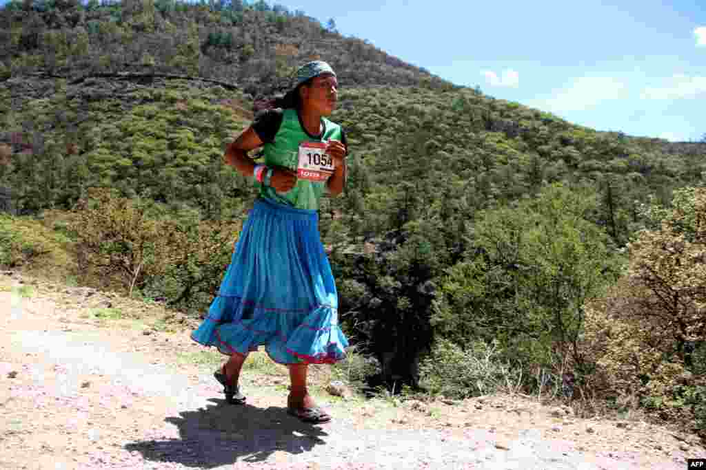 "A Raramuris indigenous woman takes part in the ""Ultra maraton de los Canones 2017"" (Ultra marathon of the Canyons), at La Sinforosa Canyon, in Guachochi, Chihuahua state, Mexico, on July 15, 2017."