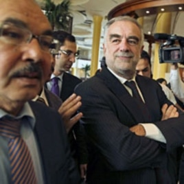 International Criminal Court (ICC) Chief Prosecutor Luis Moreno-Ocampo (C) visits Tripoli November 22, 2011