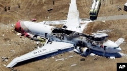The wreckage of Asiana flight 214 at San Francisco International Airport.