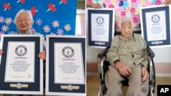 This combination of two undated photos released by Guinness World Records on Tuesday, Sept. 21, 2021, show sisters Umeno Sumiyama, left, and Koume Kodama at separate nursing homes in Shodoshima island, left, and Oita prefecture, Japan.