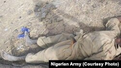 A Boko Haram fighter lies dead after an attack on Dikwa, Borno State, Nigeria, February 24, 2016.