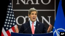 U.S. Secretary of State John Kerry gestures during a news conference, at NATO headquarters in Brussels, Belgium, April 23, 2013.