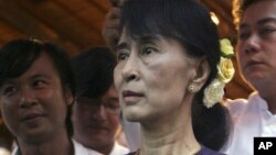 """Burma's opposition leader Aung San Suu Kyi during the opening ceremony of a photo exhibition entitled """"Aung San Suu Kyi, The Burmese Way to Democracy"""" at Institute of French in Rangoon, May 17, 2012."""