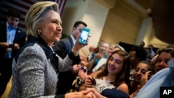 Democratic presidential candidate Hillary Clinton greets members of the audience after speaking at a rally at the International Brotherhood of Electrical Workers Circuit Center in Pittsburgh, Tuesday, June 14, 2016. (AP Photo/Andrew Harnik)