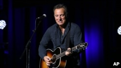 FILE - Bruce Springsteen, shown performing in New York on Nov. 10, 2015, canceled a concert in North Carolina to protest a new transgender law.