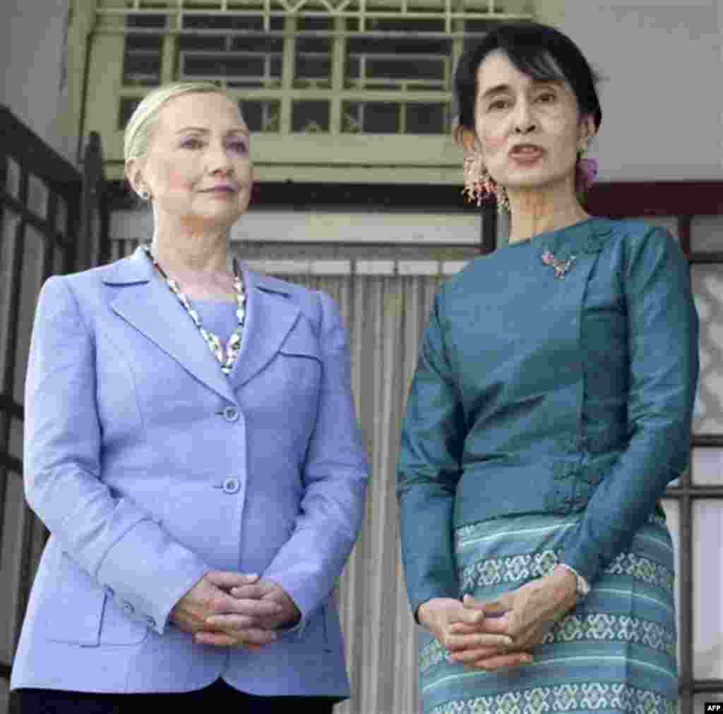 Myanmar's pro-democracy opposition leader Aung San Suu Kyi, right, speaks along with U.S. Secretary of State Hillary Rodham Clinton after a meeting at Suu Kyi's residence in Yangon, Myanmar, Friday, Dec. 2, 2011. U.S. Secretary of State Clinton and opposi