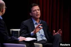 Former FBI director James Comey speaks about his book during an onstage interview with Axios Executive Editor Mike Allen at George Washington University in Washington, April 30, 2018.