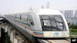 In this file photo, a maglev train runs in this Sept. 25, 2006 file photo in Shanghai, China. (AP Photo/Eugene Hoshiko, File)