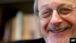 FILE - In this April 27, 2004 file photo, author E.L. Doctorow smiles during an interview in his office at New York University.