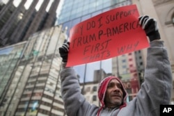A supporter of President Donald Trump chants slogans during a March 4 Trump rally on Fifth Avenue near Trump Tower in New York, , March 4, 2017.