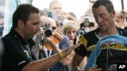 Johan Bruyneel (izquierda) junto a su pupilo, Lance Armstrong, en julio de 2009, en Mónaco.